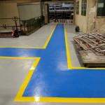 Realizzazione di massetto resinoso presso stabilimento industriale.